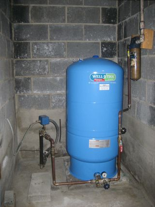 Typical water tank inside home with well water